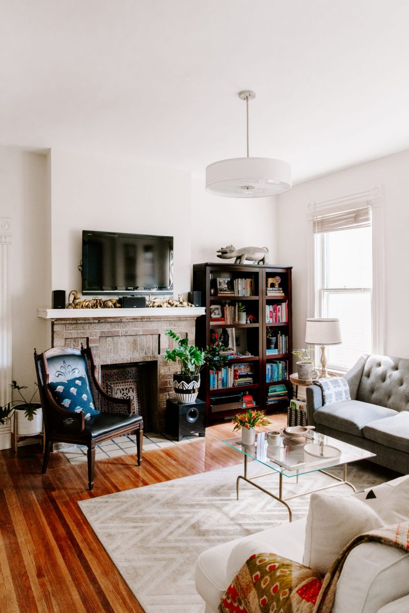 East and Gray Victorian living room utilizing sustainable design