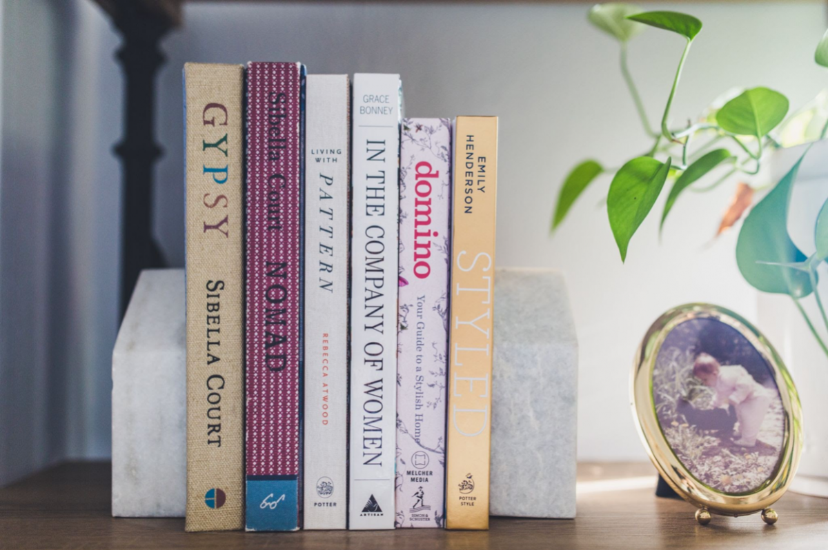A small collection of books between marble book holders.